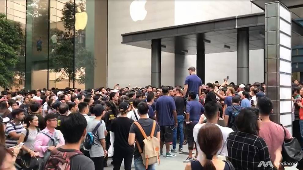 iPhone frenzy as fans queue outside stores